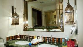 DUBAI, UNITED ARAB EMIRATES, UAE - NOVEMBER 20, 2017: Hotel Jumeirah Al Qasr Madinat, Modern luxury bathroom, decorated. In Arabic style, with big mirror on the stock video
