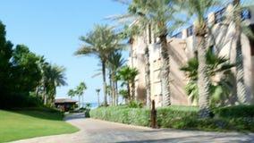 DUBAI, UNITED ARAB EMIRATES, UAE - NOVEMBER 20, 2017: Hotel Jumeirah Al Qasr Madinat , morning walk around the hotel on. A bus-bug, all the greens are in the stock video footage