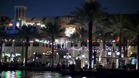DUBAI, UNITED ARAB EMIRATES, UAE - NOVEMBER 20, 2017:Hotel Jumeirah Al Qasr Madinat ,night walk along the water canal. On a boat. The lanterns illuminate the stock video footage
