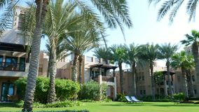 DUBAI, UNITED ARAB EMIRATES, UAE - NOVEMBER 20, 2017: Hotel Jumeirah Al Qasr Madinat , walk around the hotel, beautiful. Garden , all the greens are in the stock video
