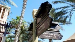 Dubai, United Arab Emirates, Uae - November 20, 2017: Hotel Jumeirah Al Qasr Madinat , walking throught the territory of. The hotel, sign of thematic direction stock video footage