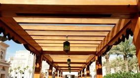 DUBAI, UNITED ARAB EMIRATES, UAE - NOVEMBER 20, 2017: Hotel Jumeirah Al Qasr Madinat, a wooden gazebo, decorated with. Lanterns in Arabic style stock video