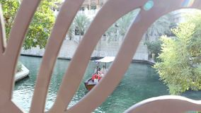 DUBAI, UNITED ARAB EMIRATES, UAE - NOVEMBER 20, 2017: Hotel Jumeirah Madinat ,day Arba boat trip on the water canal in. The hotel complex. family vocation stock video footage