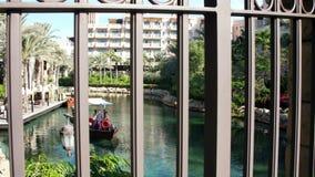 DUBAI, UNITED ARAB EMIRATES, UAE - NOVEMBER 20, 2017: Hotel Jumeirah Madinat ,day Arba boat trip on the water canal , in. DUBAI, UNITED ARAB EMIRATES, UAE stock footage