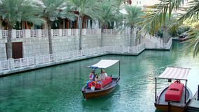 DUBAI, UNITED ARAB EMIRATES, UAE - NOVEMBER 20, 2017: Hotel Jumeirah Madinat ,day Arba boat trip on the water canal in. The hotel complex. family vocation stock footage