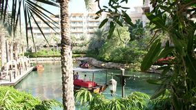 DUBAI, UNITED ARAB EMIRATES, UAE - NOVEMBER 20, 2017: Hotel Jumeirah Madinat ,day Arba boats trips on the water canal. In the hotel complex. family vocation stock video