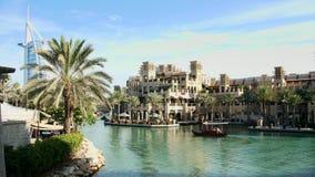 DUBAI, UNITED ARAB EMIRATES, UAE - NOVEMBER 20, 2017: Hotel Jumeirah Madinat , near Burj al Arab. day Arba boat trip on. The water canal in the hotel complex stock footage
