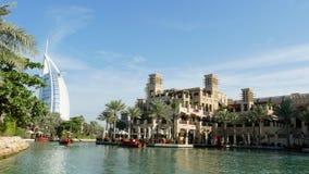 DUBAI, UNITED ARAB EMIRATES, UAE - NOVEMBER 20, 2017: Hotel Jumeirah Madinat , near Burj al Arab. day Arba boat trips on. The water canal in the hotel complex stock video