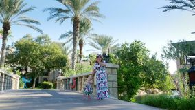 Dubai, United Arab Emirates, Uae - November 20, 2017: Hotel Jumeirah Madinat, with own artificial canals. mother with. Baby daughter walk on the bridge over the stock video