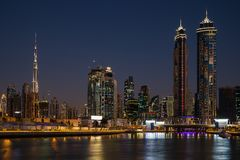 Dubai water channel at night in district area Business Bay. DUBAI, UAE - NOVEMBER 29, 2017: Dubai water channel at night in district area Business Bay royalty free stock images
