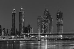 Dubai water channel at night in district area Business Bay. DUBAI, UAE - NOVEMBER 29, 2017: Dubai water channel at night in district area Business Bay stock image