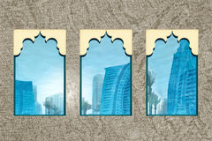Dubai Window Reflections. Abstract skyscraper reflection of dubai, through an illustration of traditional window shapes stock photography