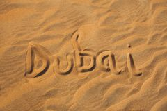 Free Dubai Word In Sand Desert Stock Image - 129253131