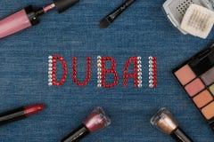 Dubai. World capitals of fashion. Word inlaid rhinestones and cosmetics. Stock Photo