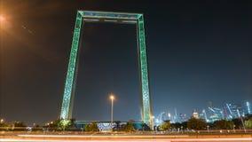 Dubaj Ramowy budynek przy nocy timelapse, nowy UAE przyciąganie Burj khalifa wśrodku Dubai ramy Żuraw budowy, Dubaj zbiory