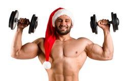 Dubbel bicep Santa Claus med den muskulösa kroppen i röd och vit jul hatt, torso Vit bakgrund som isoleras, bara Royaltyfria Bilder