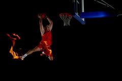 Dubbel exponering av basketspelaren i handling arkivfoto