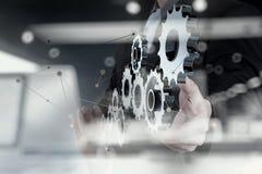 Dubbel exponering av det mänskliga kugghjulet för affärsmanhandshow till framgång royaltyfri foto