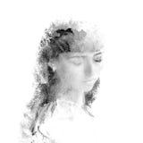 Dubbel exponering av en ung härlig flicka Målad stående av en kvinnlig framsida Mång--färgad bild som isoleras på vit bakgrund Fotografering för Bildbyråer