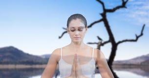 Dubbel exponering av kvinnan som mediterar med sjön i bakgrund fotografering för bildbyråer