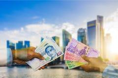 Dubbel exponering för pengarutbyte, Singapore dollar och thailändsk baht Arkivbild