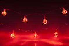 Dubbel kedja för rött ljus Arkivfoto