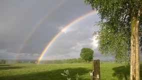 Dubbel regnbåge Ardennes Belgien Fotografering för Bildbyråer
