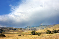 Dubbel regnbåge i Yellowstone Arkivbild