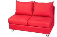 Dubbel soffa som stoppas i rött tyg som isoleras på vit royaltyfri fotografi