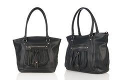 Dubbel svart läderhandväska på vit bakgrund Royaltyfri Fotografi