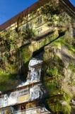 Dubbele blootstelling-hoge huis-rots met snel aftakkingswater Royalty-vrije Stock Fotografie