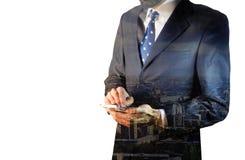 Dubbele blootstelling van stad en zakenman Stock Foto's