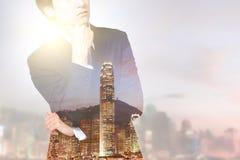 Dubbele blootstellings commerciële mens en stad Stock Afbeeldingen