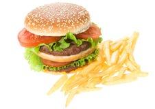 Dubbele hamburger met groenten en gebraden gerechten Royalty-vrije Stock Foto