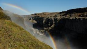 Dubbele regenboog over de canion dichtbij de Dettifors-Waterval Stock Fotografie