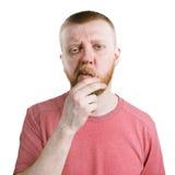 Dubbio dell'uomo barbuto in una camicia fotografie stock libere da diritti