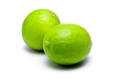 dubbla gröna limefrukter royaltyfria foton