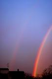 dubbla lyckaregnbågar två Arkivfoto