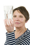 Dubious views of a glass of water Royalty Free Stock Images