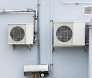 Duble air compressor unit. Is hanging on the wall of office building royalty free stock photo
