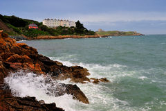 Dublin Bay. Waves breaking on rocks near Dalkey, Dublin Bay, Ireland Stock Images