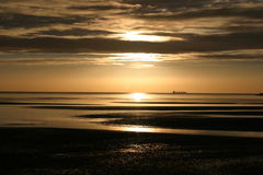 Dublin bay at dawn. Photo of a tanker leaving dublin bay just after dawn royalty free stock image