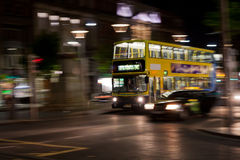 Dublin bus at night. Blurred Dublin bus at night Royalty Free Stock Photos