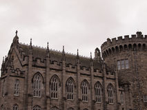 Dublin Castle. Elaborate Windows and Stone Work define the picturesque castle walls and façade. Color image taken on a bright overcast day Royalty Free Stock Photography