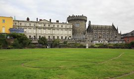 Dublin Castle, seen from park to the south. Dublin, Ireland - August 20, 2014: Dublin Castle, seen from the park to the south, outside the walls Stock Image