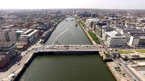 Dublin Centre from the air. Aerial view of Dublin City Centre captured with a drone. Samuel Beckett bridge in the foreground, with the river Liffey running down stock photography