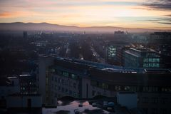 Dublin cityscape, sunset over office buildings and church. Beautiful evening over Dublin, orange sky, violet shadows over the city Stock Photo