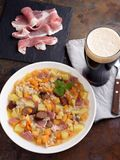 Dublin coddle. Traditional Irish dish Dublin coddle with sausages and beer on a table stock photos