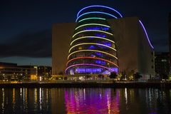 Dublin Convention Centre lit in rainbow colors. The Dublin Convention Centre lit up with rainbow colours at night, reflecting onto the river Liffey Royalty Free Stock Photos