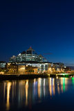 Dublin Docklands at Night. Modern HQ building in Dublin's Docklands area photographed at dusk with the lights reflecting off the river Liffey Royalty Free Stock Images